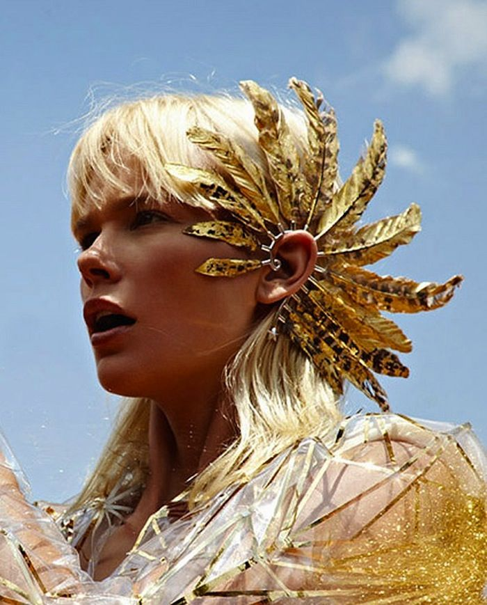 festival feathers via free people, just imagine her with Swati's Laksmi's Little Leaves in each ear??