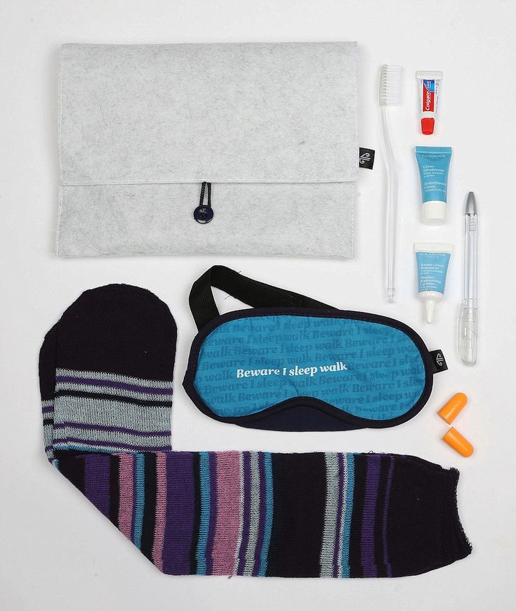 Five stars: Air New Zealand's unisex Premium Economy and Business Class kit comes with socks in Air NZ cabin crew colours, toothbrush, toothpaste, novelty 'Beware I sleep walk' eye mask, Air NZ pen, ear plugs and Clarins HydraQuench cream and lip balm