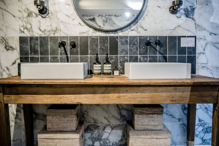 Houzz of 2018 bathroom - marble tiles, matt black accessories and crittall shower screen. The bathroom everyone is talking about!  Double sinks on old table. Love this idea!