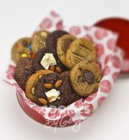 George Tin — 13 gourmet cookies gift wrapped in a shiny red tin with cellophane, ribbon, and a gift tag