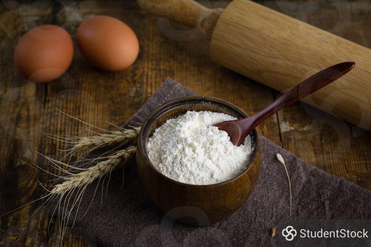 Flour, eggs, rolling tin and wheat ears - rustic still life. By Vladislav Nosick
