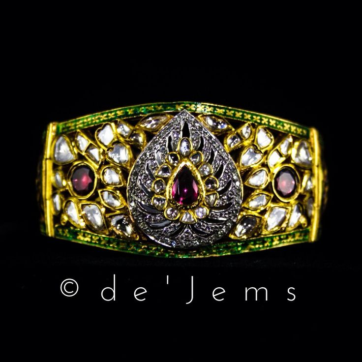 Jadau bracelet, featuring diamonds, uncut diamonds, and tourmaline gemstones set in pure gold, surrounded by meenawork. For Rs.2,35,000/- only.