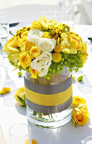 This is so simple, but so pretty. Band of colored paper, ribbon on top. To complement the flowers or in seasonal colors. Either way, really pretty.