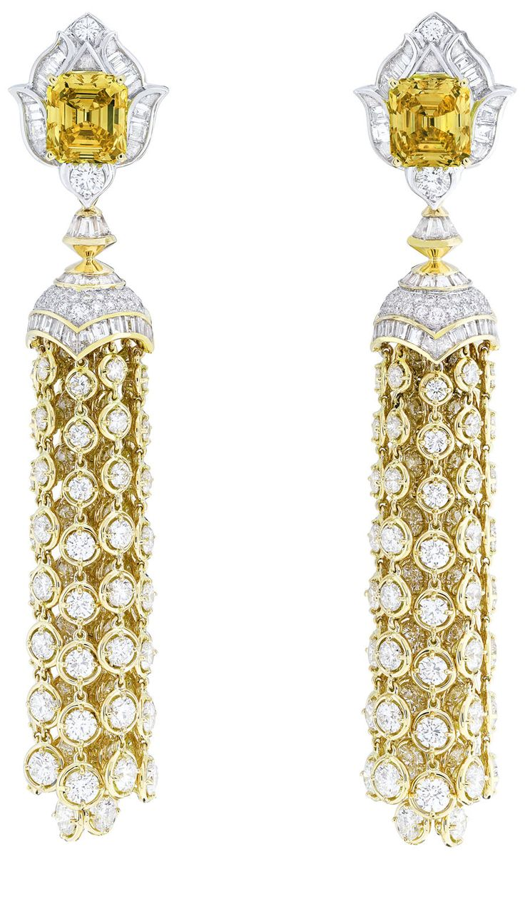 Van Cleef & Arpels Precious Light earrings with baguette cut diamonds, emerald cut fancy vivid orange yellow diamonds, set in white gold and yellow gold.