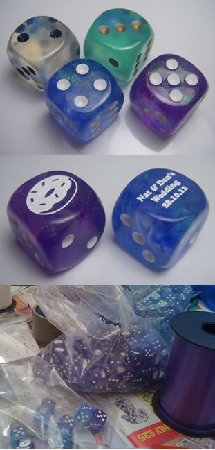 "Gary wants these bad to give to our guests. I supposed it's a tad better than ""  silver dolphin shaped wine opener.""    Cool board gamer/geek wedding favour idea - choose your favourite dice and get them custom engraved!!  Give each guest a set of dice wrapped in a ribbon tied cellophane bag!  ~~~  Even if some of your guests aren't gamers, EVERYONE needs dice!"