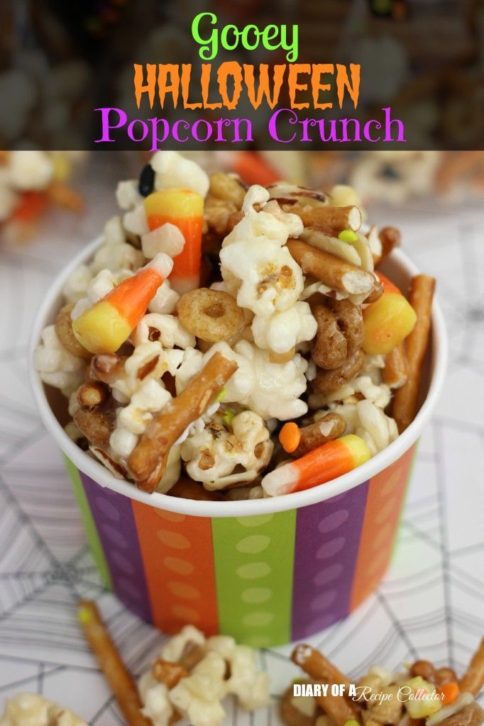Gooey Halloween Popcorn Crunch-Popcorn, pretzels, candy corn, almonds, and cereal all mixed up in the most wonderfully addicting sugar coating!