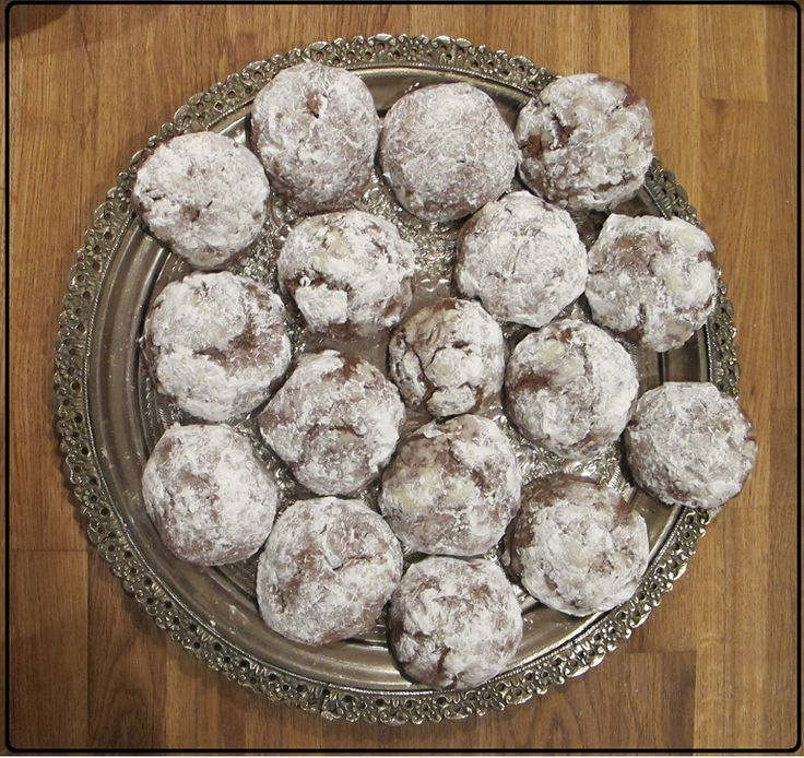 Chocolate Crackles.  Chocolate cookie dough rolled into a ball, coated in icing sugar and thrown into the oven.