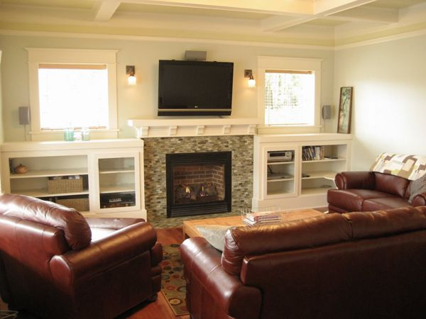 Tv fireplace sconces builtins fire place entertainment for Small living room arrangements with tv and fireplace
