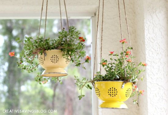 A colander gets a second life as a hanging flower pot.  Just line the inside with landscaping cloth and tie rope to the handles for rustic porch decor.
