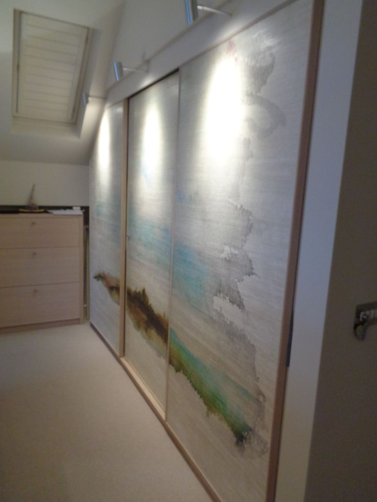 Sliding wardrobe doors with feature landscape wallpaper