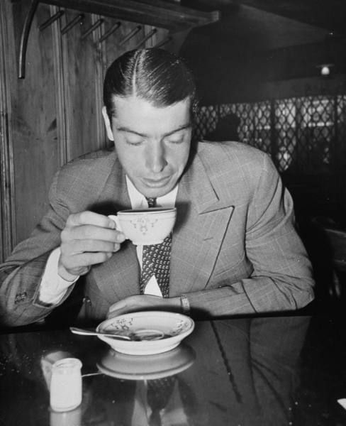 Joe Dimaggio with a cup of coffee, 1939