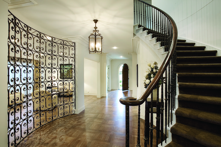 Curved Stairs With Wrought Iron Baluster, Timber Handrail And Carpet Finish. Ravida- Property With Distinction