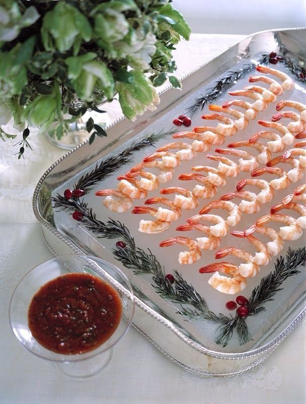 A decorated block of ice is an elegant serving tray for chilled food, such as shrimp cocktail.  (Martha Stewart Christmas Vol. 5 2001)  (No link, just photo)