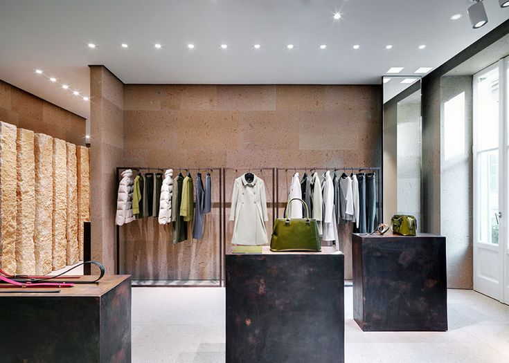 Interior of the Giada Milan flagship store by Claudio Silvestrin. Beautiful cast bronze pedestals.