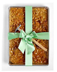 Cute Gift: Give a gift of peanut brittle in a special baking dish and great big satin bow with a tiny hammer for the recipient to break it up!