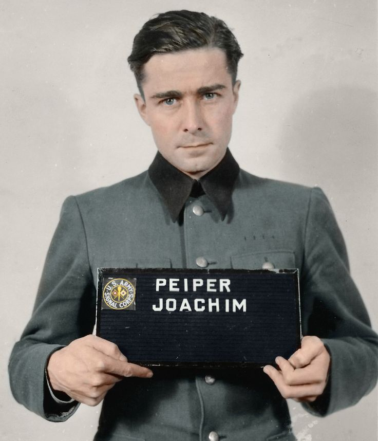 Joachim Peiper (1915-1976) was a an SS-Standartenführer in the Waffen-SS during WWII and personal adjutant to Heinrich Himmler between November 1940 and August 1941. (Colourised)