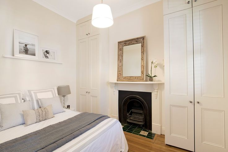 Main bed, fireplace, throw cushions, mirror, wall art, pretty terrace, immaculate interiors, 20 Ferris Street, Annandale, Pilcher Residential