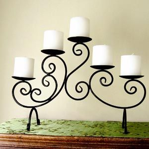 candleabras are year-round accessories and love the simple but elegant scroll of our wrought iron pillar candle holder.