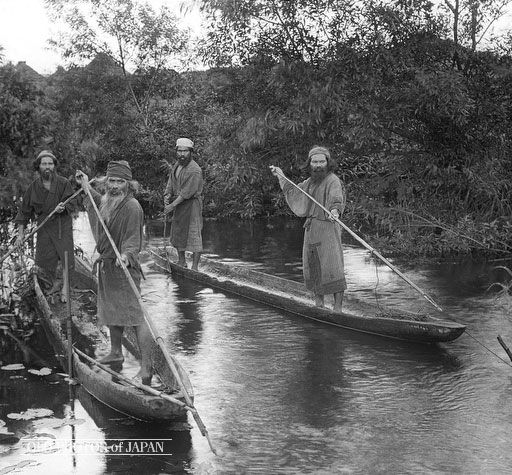 early 1900's. Ainu Fishermen in Log Boats. Four Ainu fishermen stand in log boats, two of them holding spears as if ready to catch fish. Fish was, together with venison and other game, a very important part of the Ainu diet. It was actually so important that in the many Ainu tales recalling famines, the cause is usually the absence of fish. #Ainu #Hokkaido #Japan