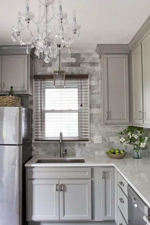 gray kitchen features gray raised panel cabinets paired with viatera snow stormu2026