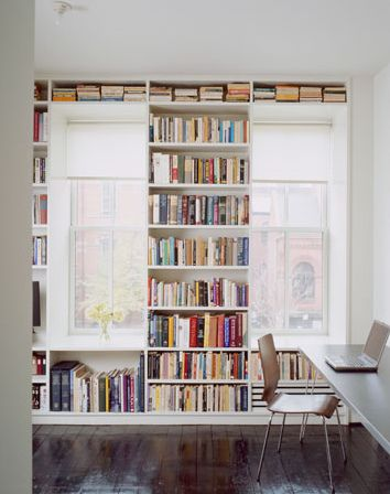 Bookshelves that frame the windows.