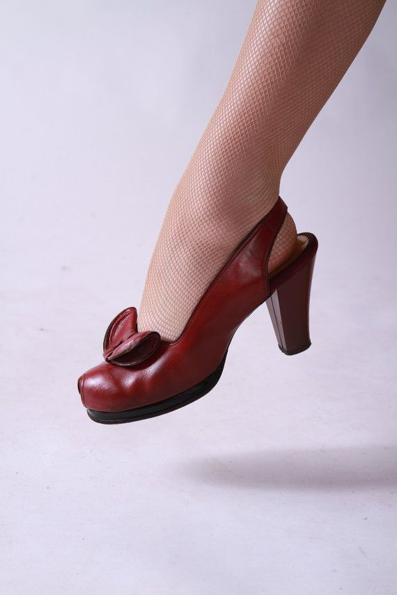Im not sure that you could find shoes with a more ideal WWII silhouette! The color? A deep and delicious Bing cherry red, almost a maroon, with with more