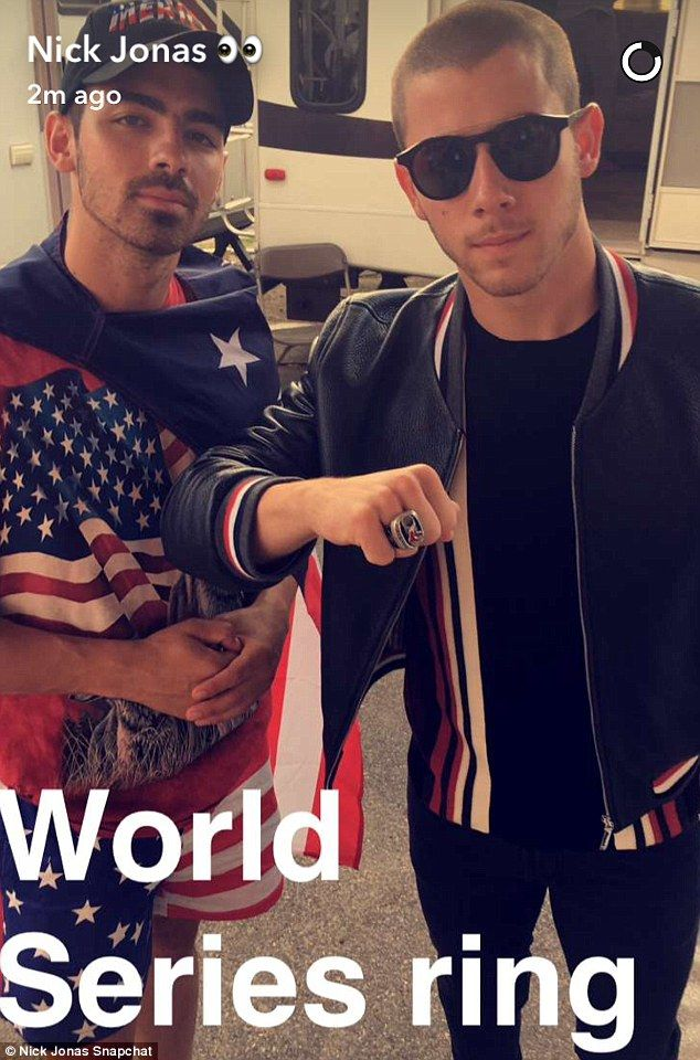 Check it out: Nick Jonas showed off his World Series Ring as he posed beside his brother Joe Jonas, who wore red, white, and blue