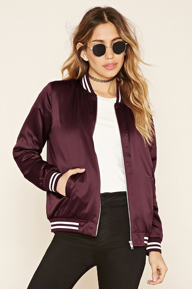 Style Deals - A padded varsity jacket featuring a sheeny design, two front slit pockets, long sleeves, zipper front, and a striped ribbed trim.