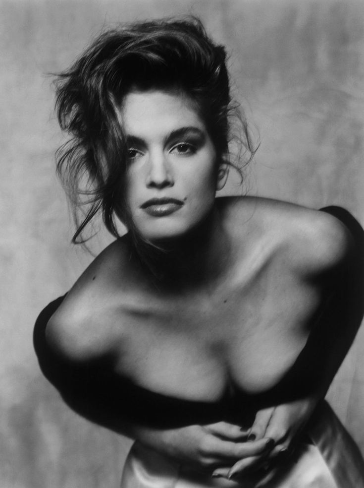 90s - Cindy Crawford.  American model. Known for her trademark mole just above her lip, Crawford has adorned hundreds of magazine covers throughout her career. Her success at modeling made her an international celebrity that has led to roles in television and film, and to work as a spokesperson.