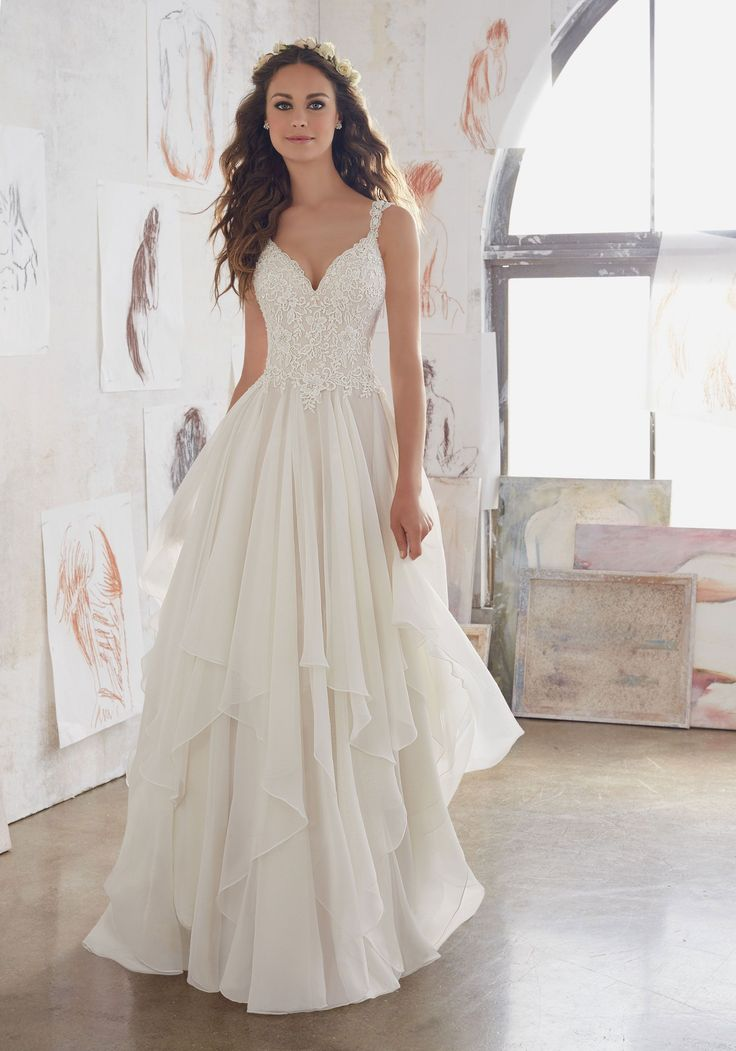 This Boho Inspired Gown Beautifully Combines Romantic Layers of Flounced Chiffon and a Fitted Bodice Adorned with Venice Lace AppliquéŽs. Illusion Back