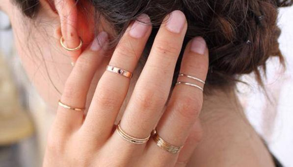 PureWow's awards for Best of the Summer via @PureWow | Best Fashion Statement: Ring Stacking: Were you looking closely at the hands of all the cool girls this summer? You may have noticed that they were sporting multiple thin gold rings on every finger--for a look that's both totally ladylike and effortlessly rock-'n'-roll. (You can pull it off too, we promise.)