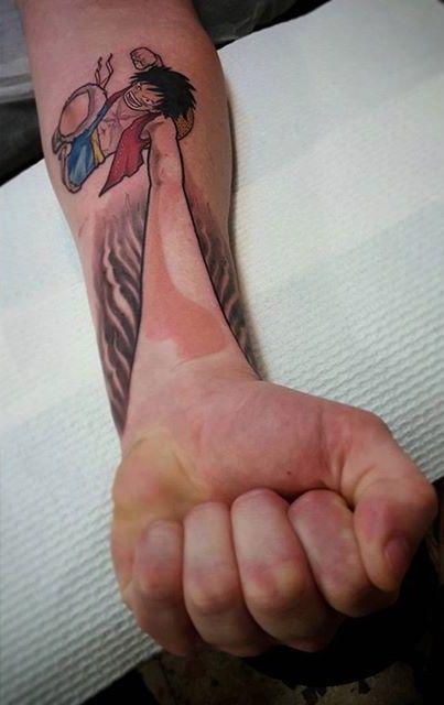 one piece tattoo by Godfrey Atlantis