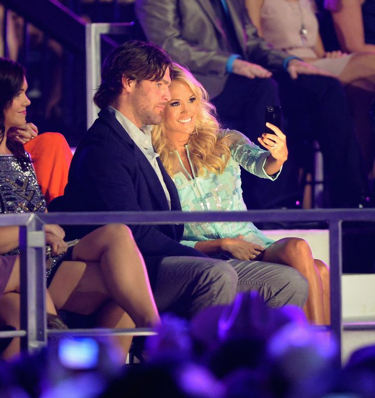 Carrie Underwood turned the camera on herself and husband Mike Fisher at the CMT Awards in Nashville in June 2013.                   Source: Getty / Jason Merritt
