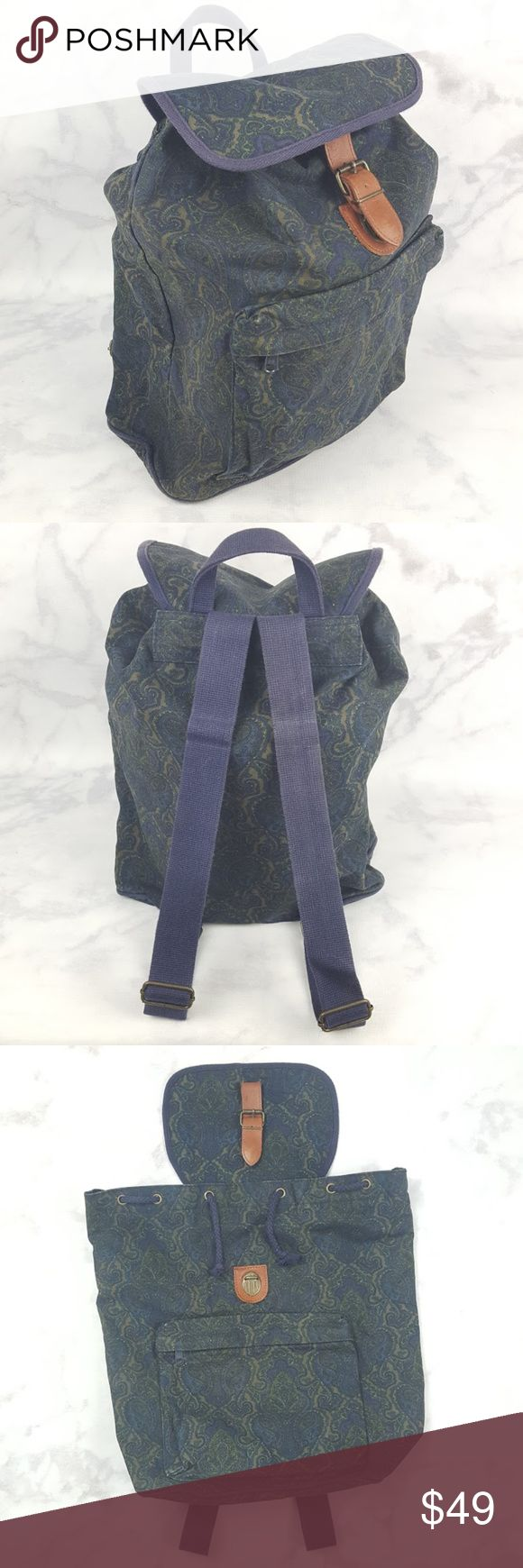 Gap Vintage 90's Navy Blue Paisley Print Backpack Gap Vintage 90's Blue & Green Paisley Print w/ Leather Strap Backpack. Navy blue & olive green paisley print. Light brown leather strap. Brass eyelets & and buckle fixtures. Navy blue cinch cord, straps, & zipper. Olive green inside. Full size backpack, zippered front pocket, & adjustable straps. Top leather strap has a few loose stitches. Excellent Used Condition. One Size. No Trades! GAP Bags Backpacks