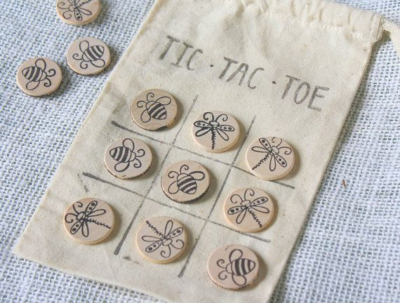 Who doesnt LOVE a good game of Tic Tac Toe?!! Super cute wooden pieces handstamped with fun designs kids will love. Perfect unique gift for