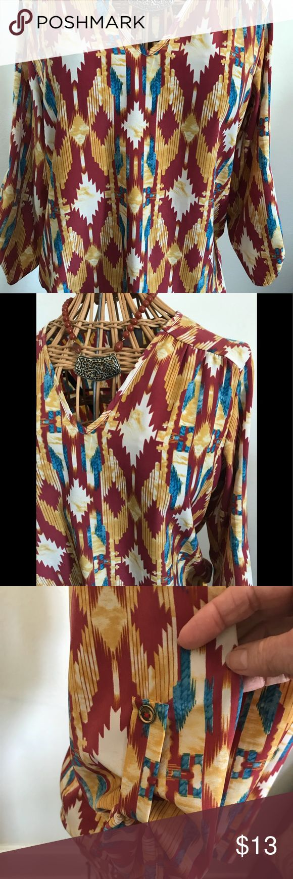 """Charles Aztec Inspired Top Yes, I love southwestern, Aztec Inspired Prints!! Great v-neck. Sleeves permanently rolled up & buttoned. Colors are mustard, blue, dark mauve & cream. Looks great with gold jewelry. Size cut out but I'm saying it's a medium.  Measures 18.5"""" from underarm to underarm  24.5"""" from top of shoulder to hem front, 25.5 in back  Sleeves 18"""" charlee Tops Blouses"""