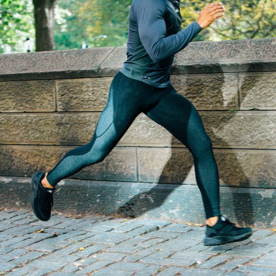Functional men's workout leggings with built-in resistance bands that trains your body when running or working out to help you perform on game day.