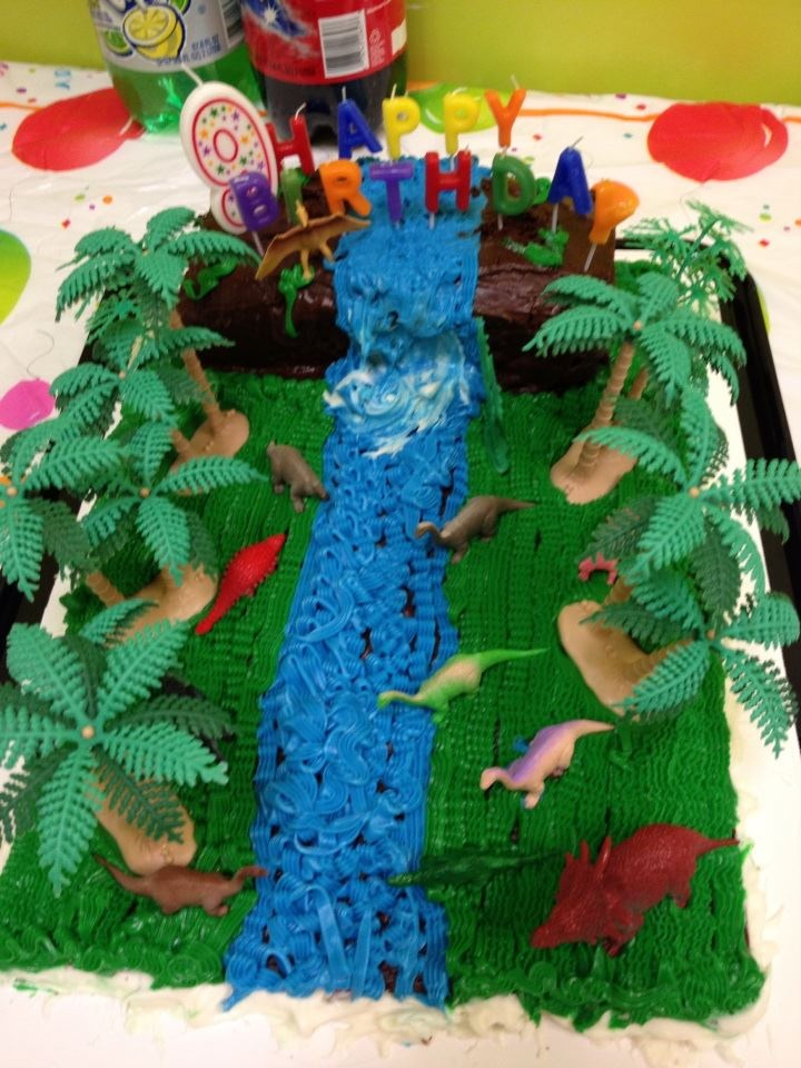 """My oldest daughter has always loved dinosaurs so for her 9th birthday she wanted a """"Great Valley"""" cake. She loves Little Foot and the Land Before Time gang. I think I had a lot of fun designing this one."""
