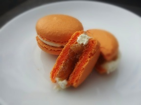 I decided double stuffed would be a great way to make the orange-creamsicle macarons I'd been imagining. Here they are with tahitian vanilla butter cream and our house-made citrus preserve.