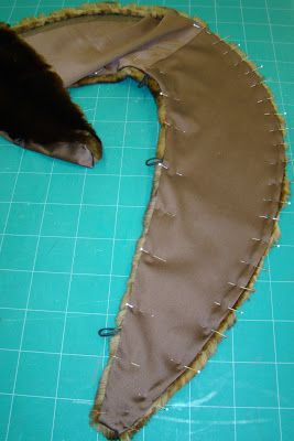 This website has lots of upscale sewing projects - nice! Go to middle of page, instructions for adding a fur collar to a coat.