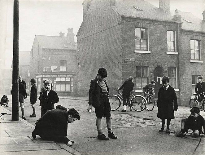 """A tense game of marbles!"" [or Taws as we called it]..A Leeds street scene by Roger Mayne, 1957.."