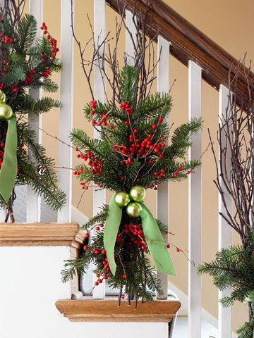 Creative idea to decorate a staircase for Christmas... Make sprays of evergreens, twigs, and berry stems. Attach to balusters; finish with Christmas balls and ribbon. (BHG)