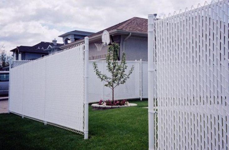 Tall White Chain Link Fence With White Privacy Slats In
