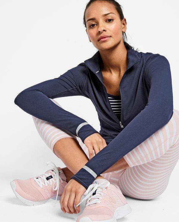 New Balance for J.Crew women's in-transit pullover, striped sports bra, performance capri leggings in stripe, and 711 mesh sneakers.