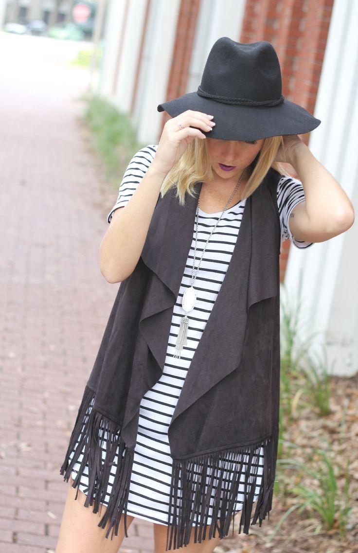 striped dress and fringe vest