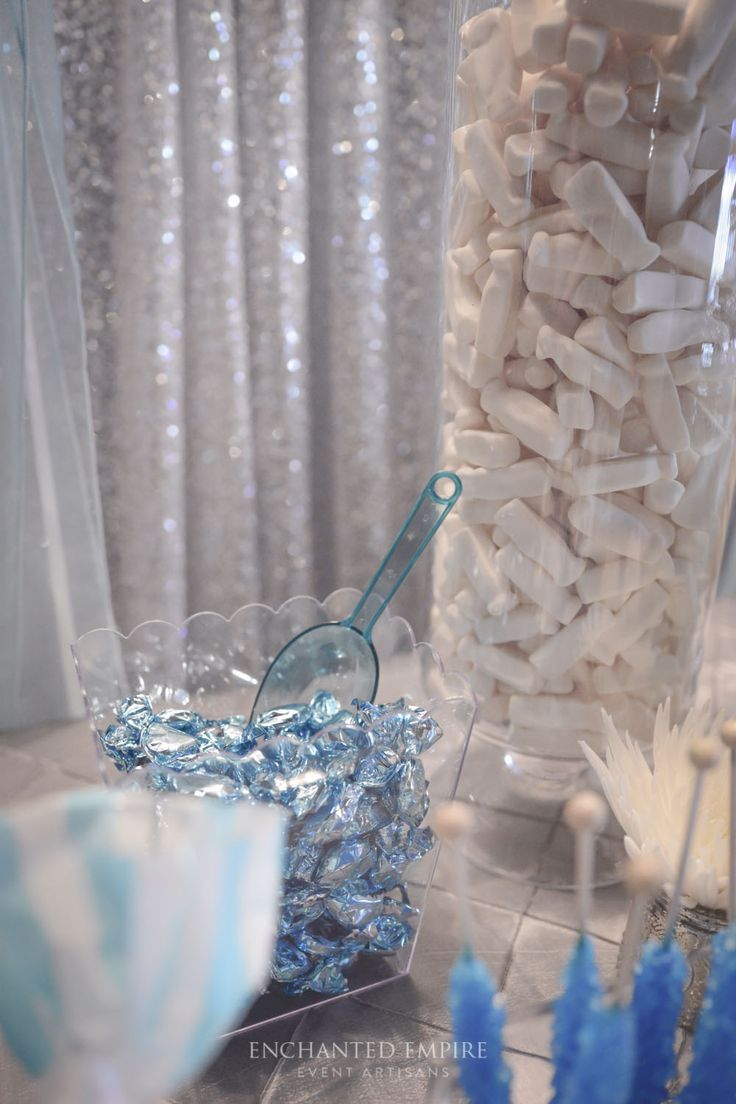 Silver Sequin backdrop, Geronimo Balloons, blue candy scoops, custom cake wraps with gourmet candy options were just some of the many featured details of this gorgeous Blue + Platinum Candy Bar. Perfect little details for the newly weds, and many a raving review from the guests!