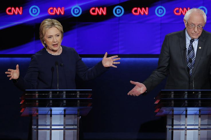 Democratic presidential candidate Hillary Clinton battles Bernie Sanders during…