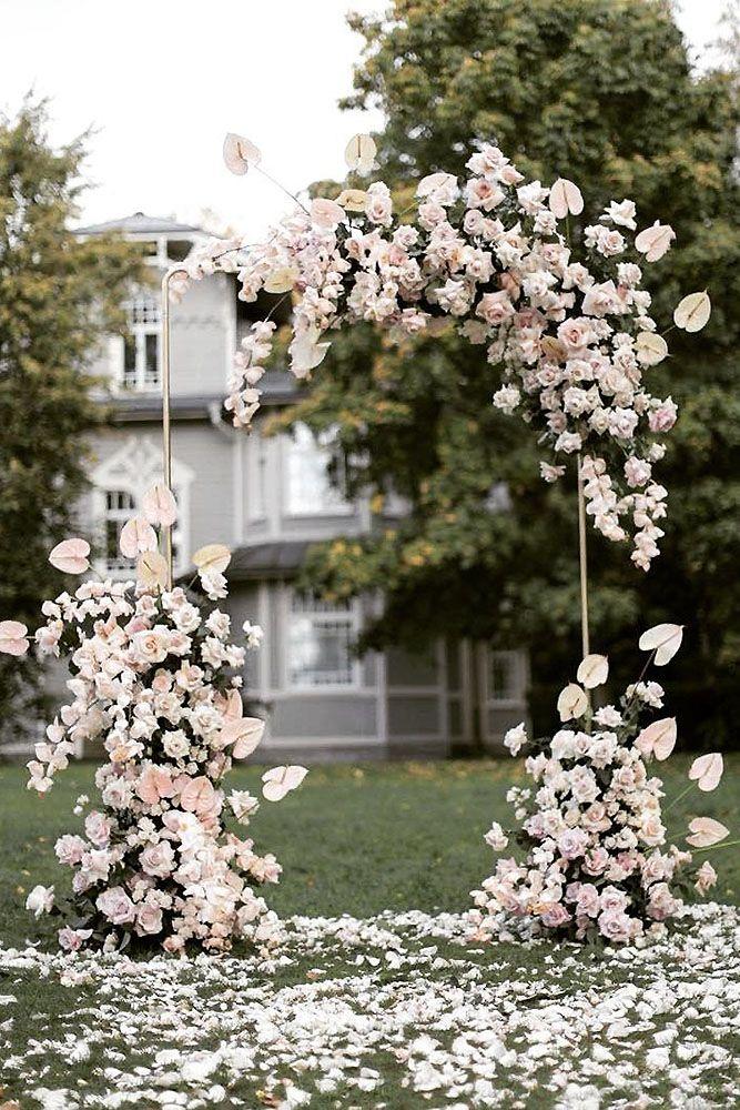Blush florals and fauna drape this modern arbor, romantic ceremony altar ideas, feminine decor, 2019 wedding trends