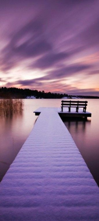 Snowy jetty at sunset in Stockholm, Sweden by Calle Höglund