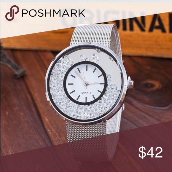 Beautiful Stainless Steel Watch Waterproof This is stunning. Stainless Steel Mesh watch with loose Crystals that move with you. Conversation starter. I have this watch & have gotten loads of compliments.  This is quality workmanship.  Quartz movement. Length is: 19.4 inches Accessories Watches